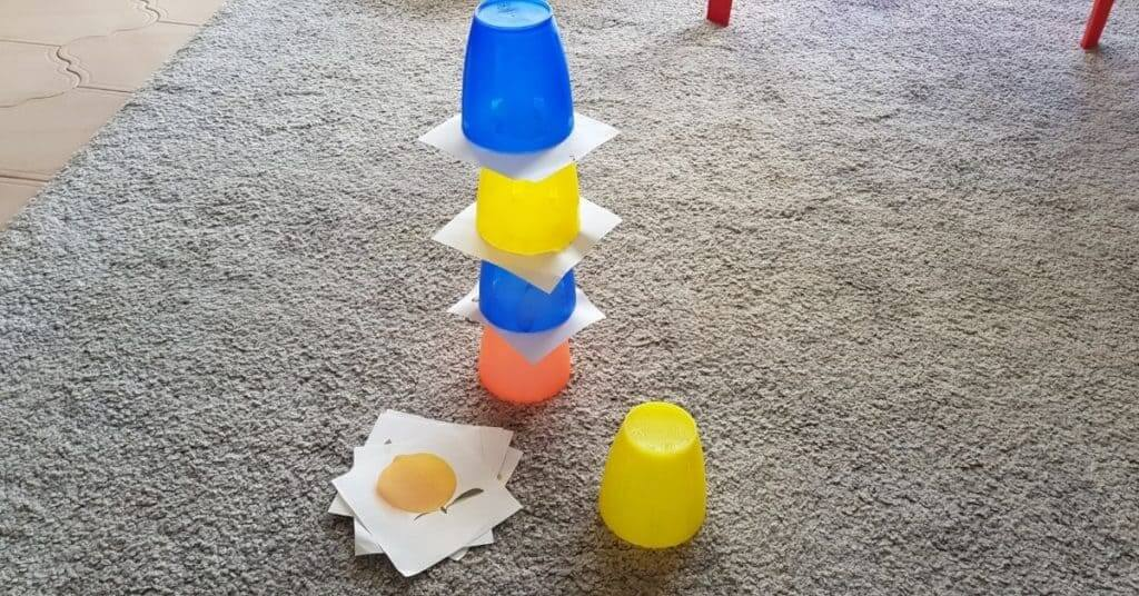 build a tower with plastic cups and mini flascards